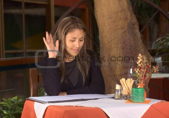 Beautiful Young Peruvian Woman Calling the Waiter