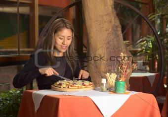 Beautiful Young Peruvian Woman Enjoying her Pizza