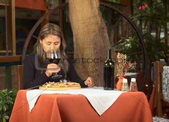 Beautiful Young Peruvian Woman Smelling at Wine