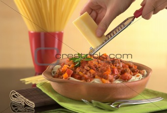 Grating Cheese over Spaghetti Bolognaise