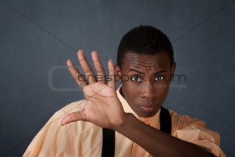 Man Holds Up His Hand