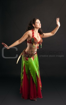 Young Arabian dancer with saber