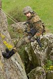 Armed soldier hanging on the rope