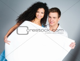 couple holding a paper