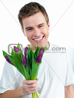 man with a bouquet of tulips
