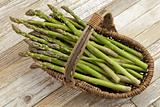 green asparagus in wicker basket