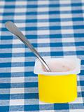 yogurt pot with spoon