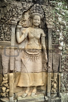 Apsara carved on the wall at bayon, cambodia