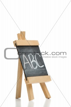 Angled chalkboard with the letters abc written on it