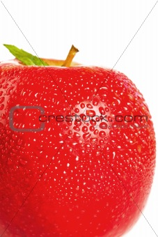 Three quarters of a red wet apple