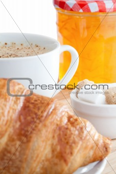 Breakfast with coffee marmalade and croissants