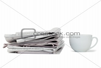 Newspapers and cup of tea