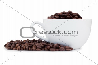 Cup full of coffee beans with coffee beans on the side