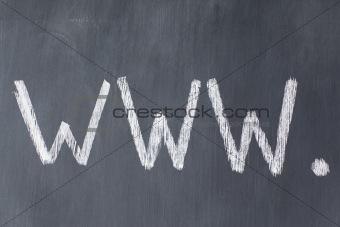 """Blackboard with letters """"www"""" written on it"""