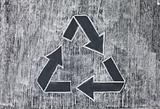 Recycle symbol on a white chalky background