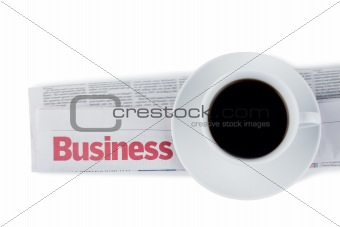 Folded newspaper and cup of coffee