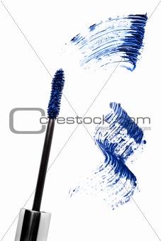 Blue mascara stroke and brush  isolated on white