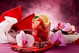 Strawberries with Orchid on red table