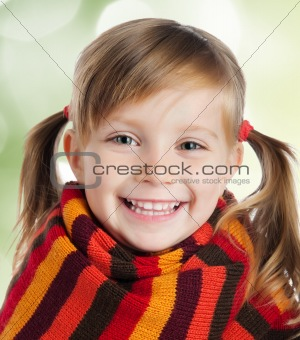 little girl in striped scarf