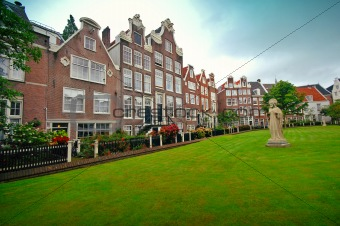 Old houses and sculpture on the lawn, Amsterdam
