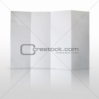 Folded white paper on white background