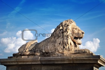 Lion statue in front of the Chain bridge in Budapest