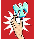 Pop art comic angel in female hand