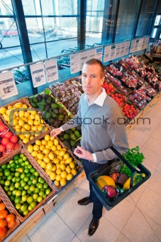 Portrait of a man buying fruits