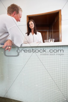 Spa receptionist with a male customer at spa