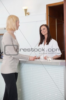 Blond girl at the reception desk