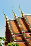detail of ornately decorated temple roof in bangkok