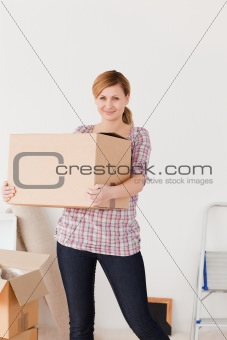 Blonde woman carrying cardboard boxes
