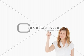 Cute woman drawing a scheme looking towards the camera