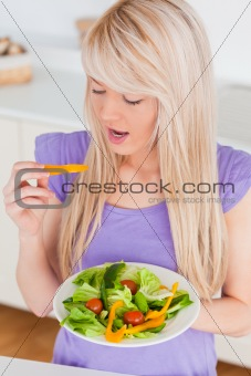 Attractive smiling female enjoying her salad