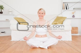 Attractive blonde woman practicing yoga
