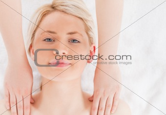 Attractive blond-haired woman having a massage