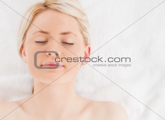 Blond-haired woman relaxing while lying down