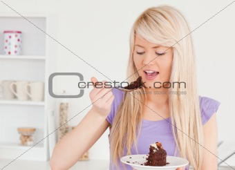 Smiling blonde woman eating cake