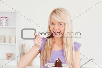 Beautiful caucasian woman eating cake