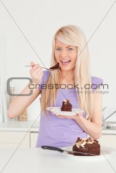 Beautiful caucasian female eating cake