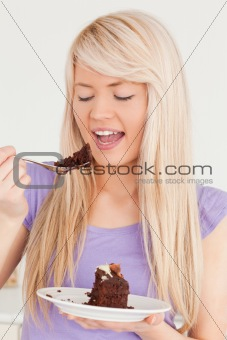 Attractive caucasian female eating cake
