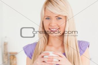 Beautiful female drinking hot drink