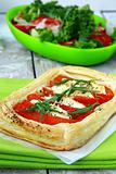tart of puff pastry with peppers and goat cheese