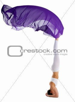 woman standing on head with purple fabric yoga chakra