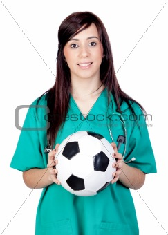 Attractive brunette doctor with soccer ball