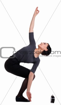 businesswoman stand in yoga with clock isolated