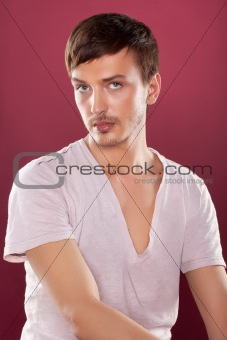 Young handsome man in a white shirt over red