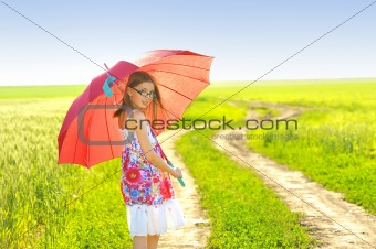 a little girl with a umbrella