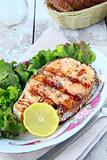 red fish salmon grilled with lemon and salad