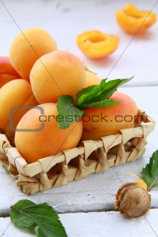 Group fruit apricot on a white table